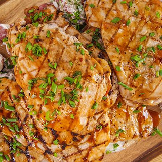 Emeril Lagasse's Grilled Pork Cutlets with Homemade BBQ Sauce and Cilantro Potato Salad.