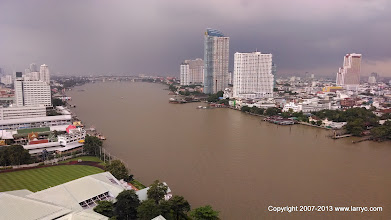 Photo: The view South down the river. Our room faced North.