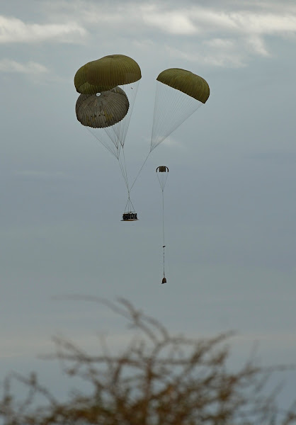 Photo: French army drop a jeep with parachutes at the Timbuktu airport on January 28, 2013. Hundreds of people gave French-led troops a hero's welcome on Monday as they entered the historic city of Timbuktu, occupied for 10 months by Islamists who imposed a harsh form of sharia.  AFP PHOTO / ERIC FEFERBERG        (Photo credit should read ERIC FEFERBERG/AFP/Getty Images)