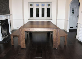 Dark Spartan Dining Table in Lounge on Dark wooden flooring