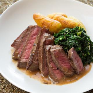 Steaks au Poivre with Crispy Fingerling Potatoes & Sautéed Kale
