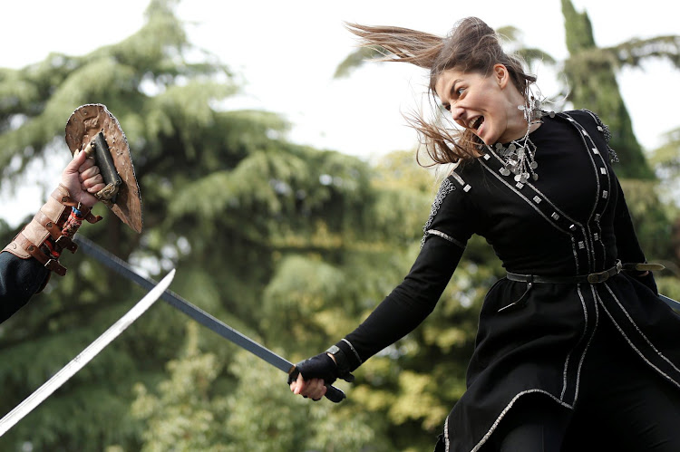 Young people perform Georgian martial arts during the annual Tbilisoba festival in Tbilisi, Georgia.