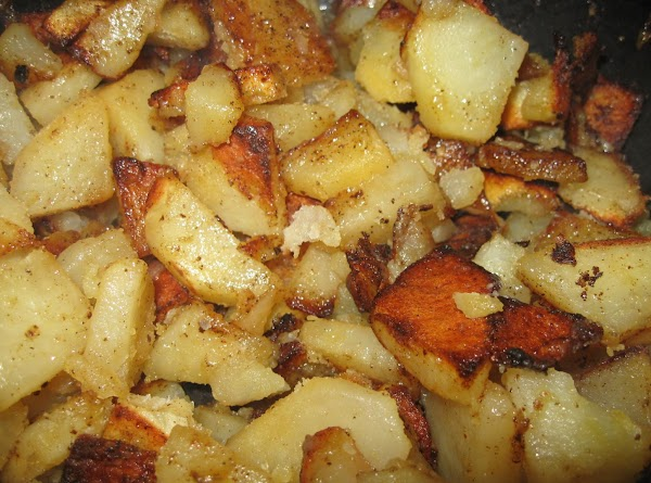 Return skillet to heat and add oil. While that gets hot, sprinkle spices onto potatoes...
