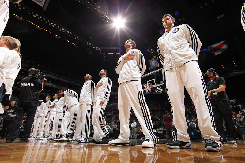 Photo: The Brooklyn Nets look on during the National Anthem before a game against the Toronto Raptors at the Barclays Center on January 15, 2013 in the Brooklyn borough of New York City in New York City.