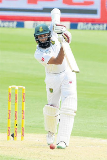 MASTER CLASS: Hashim Amla slammed a century, his first score past the 50 mark in 14 trips to the crease, to help steer the Proteas to a commanding position in the third and final Test against Sri Lanka yesterday Picture: GALLO IMAGES
