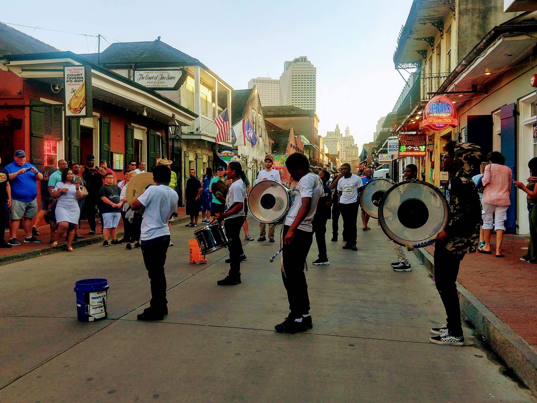 Street performers/ Drum line performing on Bourbon Street one afternoon in New Orleans Louisiana.