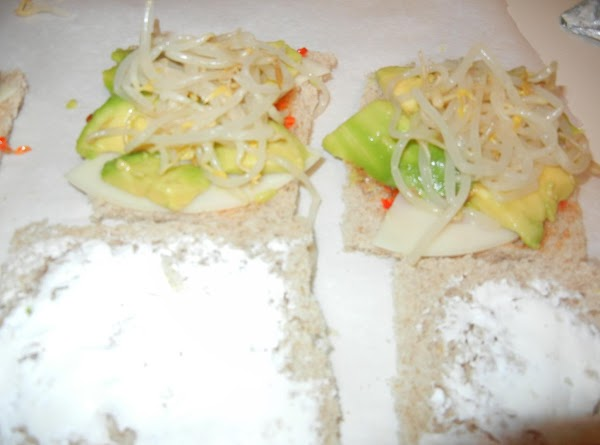 Layer each cheese, avocado and bean sprouts.