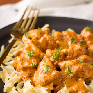 Hungarian Chicken Paprikash Over Egg Noodles (Csirkepaprikás).
