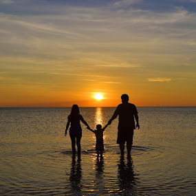 I, my wife and  my son sharing the beautiful moment together by Christianto Mogolid - People Family ( sahing the beauty of nature, dad with kids, sunset, love all around the world, happy family, together in love, mom with kids, holding hands )