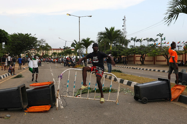A demonstrator sits on a barricade during 'End Sars' protests in Lagos, Nigeria, on October 20 2020.