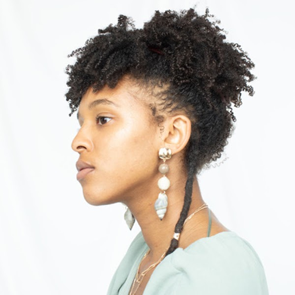 Side profile of artist wearing a light top.