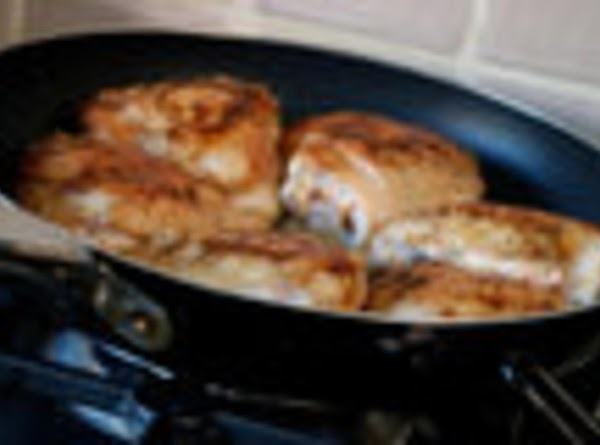 IN A LARGE DEEP FRY PAN, MELT BUTTER AND OIL ON MEDIUM HEAT; ADD...