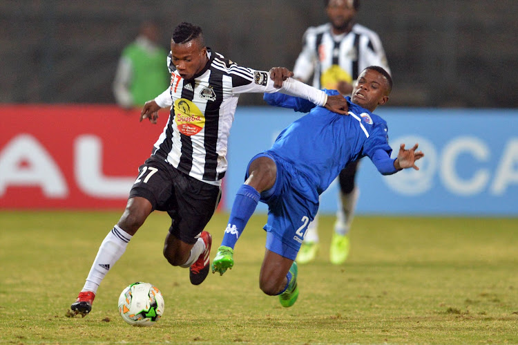 Michee Mika of TP and Teboho Mokoena of SuperSport during the CAF Confederations Cup match between SuperSport United and TP Mazembe at Lucas Moripe Stadium on June 20, 2017 in Pretoria, South Africa.