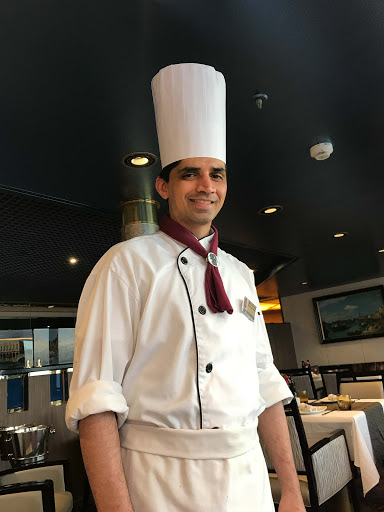 specialty-restaurant-chef.jpg - Amit Asthana, the specialty restaurant chef on ms Oosterdam, during dinner at Canaletto.