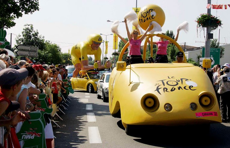The Tour de France publicity caravan drives past spectators . Picture: REUTERS