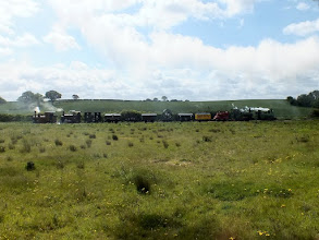 Photo: 019 Joining the queue of trains behind us on the loop was the demonstration goods train, seen here in full profile. How many narrow gauge railways have you visited where an 8 wagon goods train is hauled/propelled by 4 steam locos ?