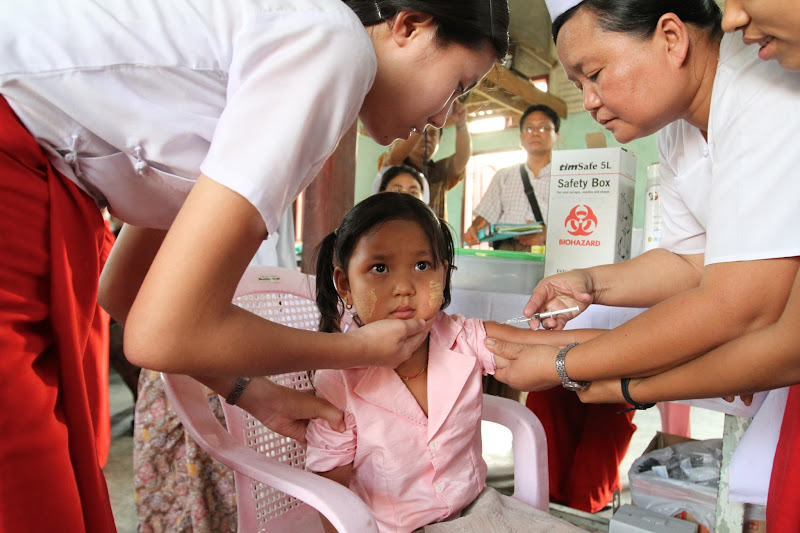 Photo: Nurses vaccinate a young girl against measles and rubella in Myanmar. Measles campaigns targeting millions of children have helped to reduce measles deaths globally by 74% this year.   Photo credit: Measles and Rubella Initiative/Christine McNab