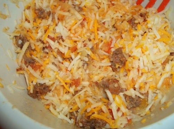 In large bowl, toss sausage mixture, potatoes and cheese. Spread into baking dish.