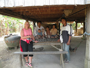 Photo: AMFW Lisa with Neal Harv and children with local volunteer, Keo