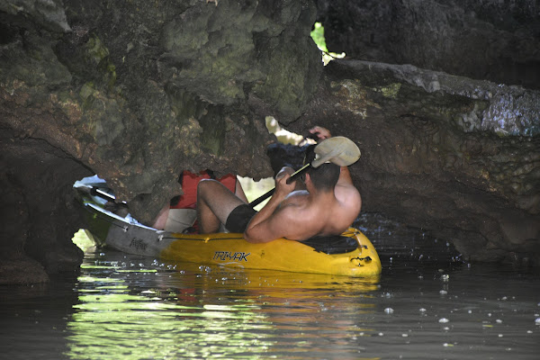 Lay down in our kayak to even get through the caves