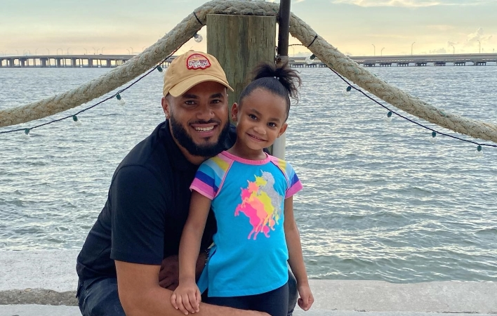 Father and daughter on a dock in Brandon, FL