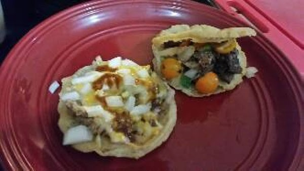 Top with your favorite toppings, beans, onion, cheese, and taco sauce.  Shredded pork,...
