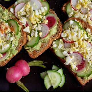 Avocado Toast with Egg, Cucumber and Radish.