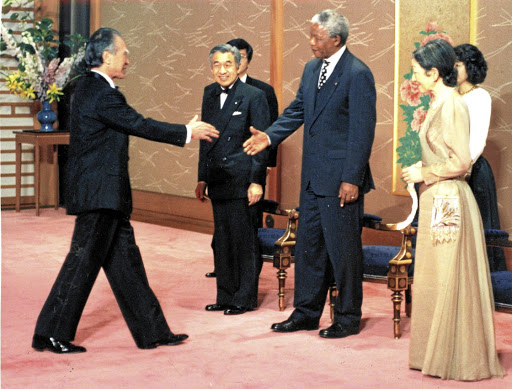 President Nelson Mandela, Japanese Emperor Akihito and Empress Michiko welcome Japanese prime minister Tomiichi Murayama at a reception at Akasaka Guest House in Tokyo in 1995.