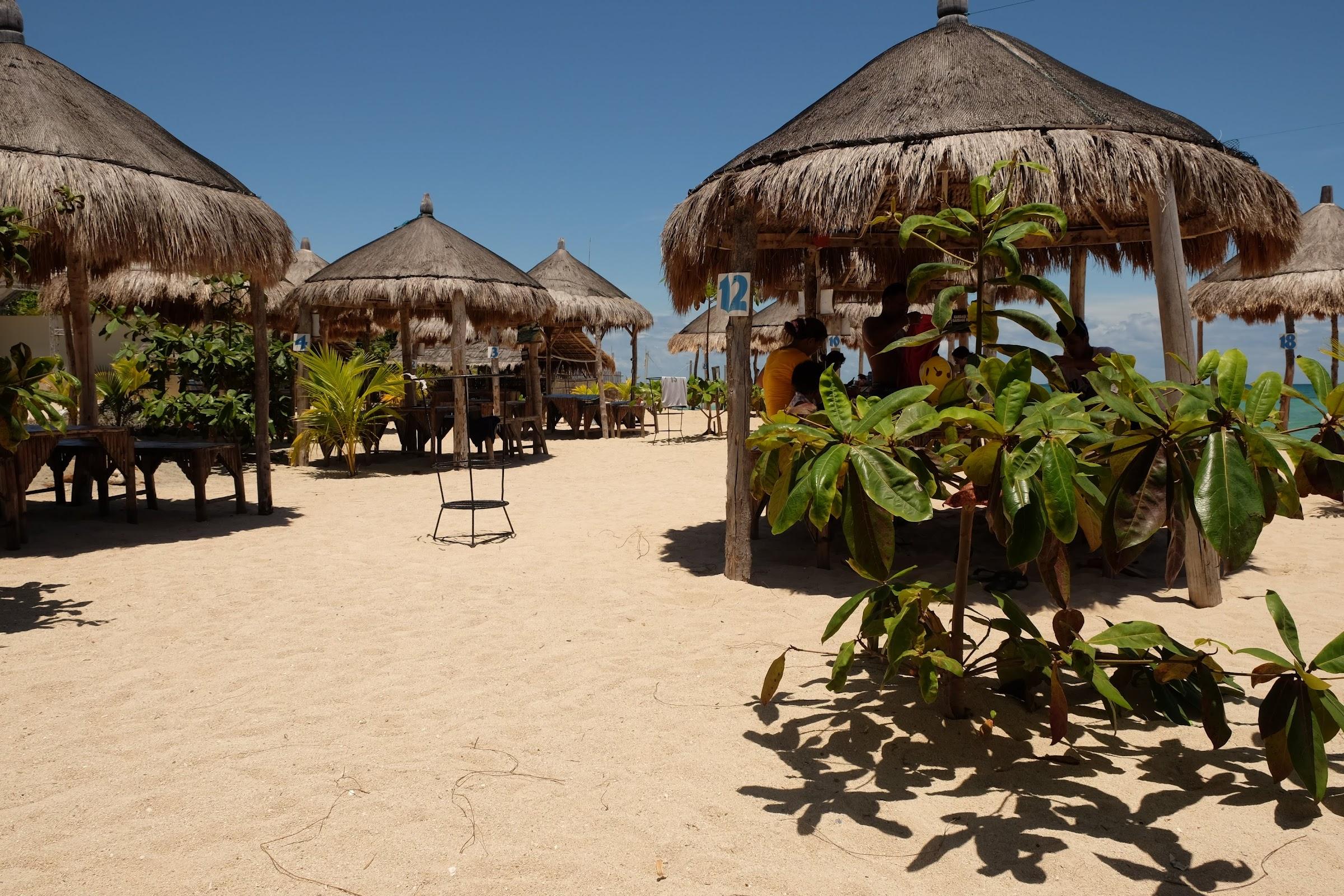 umbrella huts in lakawon island daytour
