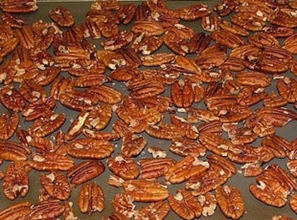 Add the pecans and stir and coat well.  Place on coated cookie sheet.  Place...