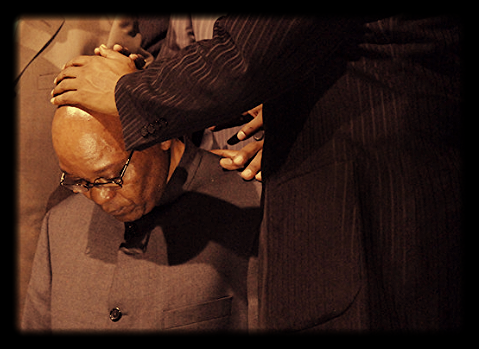 South African President Jacob Zuma kneels as a pastor prays for him. Picture: REUTERS