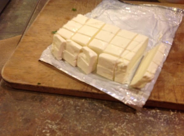 Stir in the cubed cream cheese, and carefully stir to mix  together as...