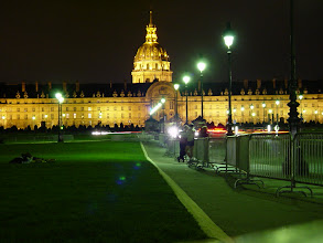 Photo: Les Invalides, an exceptional example of Baroque architecture, at night. Napoleon's tomb (a series of six nested coffins!) is under the dome. The other buildings house several museums, including one of the world's foremost military museums.