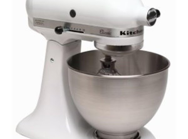 Activate yeast in the work bowl of a large stand mixer.   ...