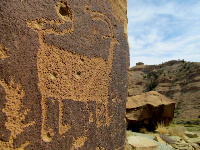 Strange bighorn sheep petroglyph and bullet holes