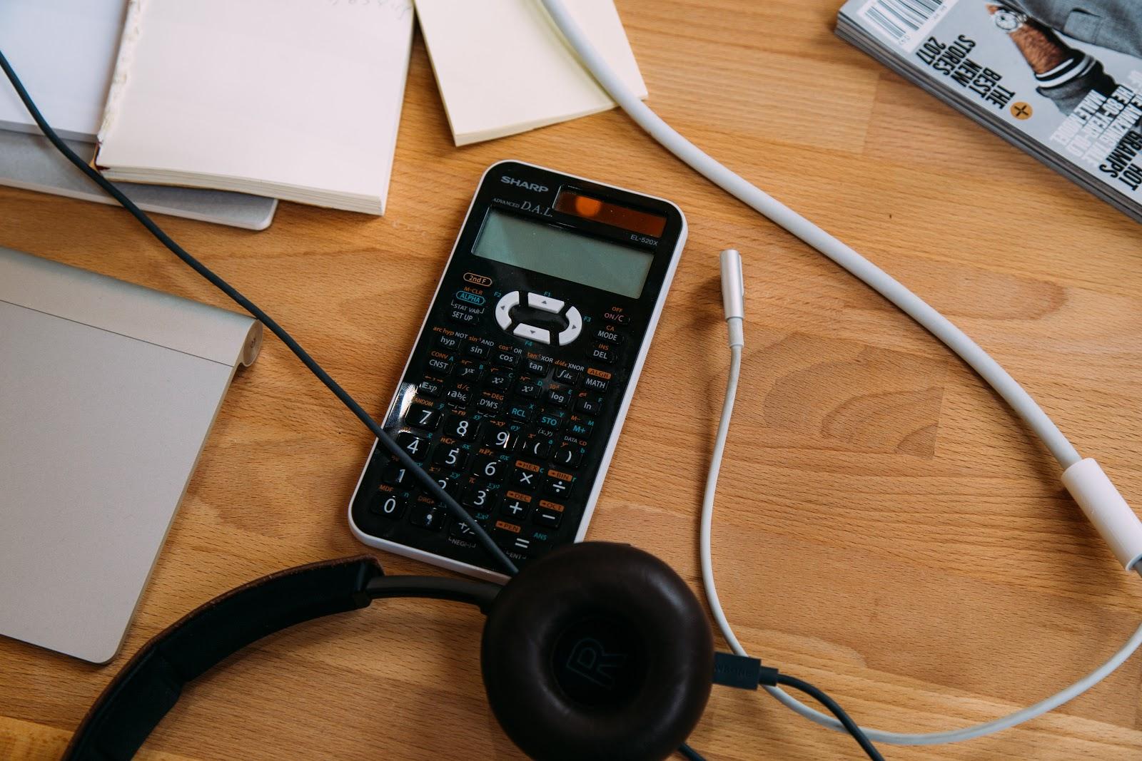 A black scientific calculator on a desk