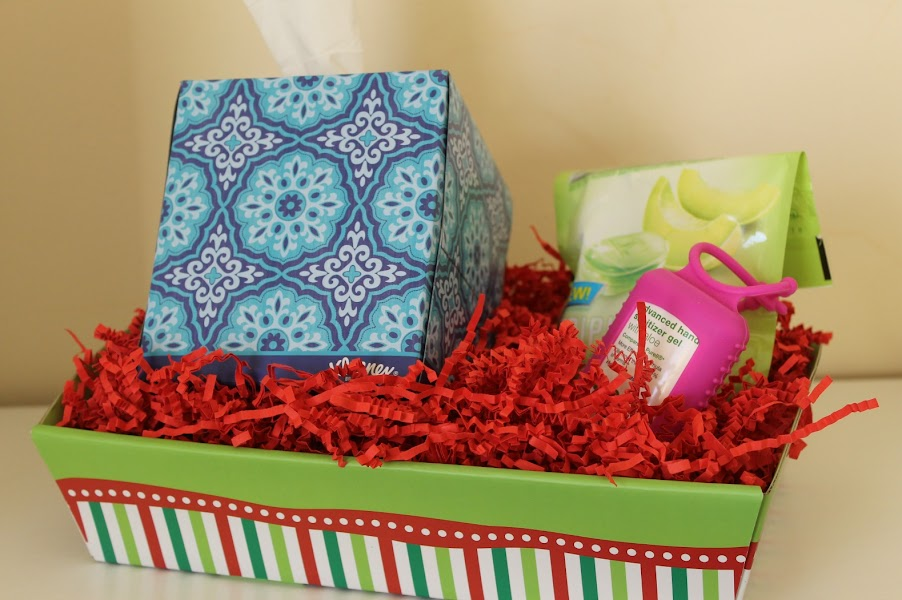 Create a care basket for your holiday guests, stocked with tissues, antibacterial gel, aspirin and more so that you can share memories without sharing germs