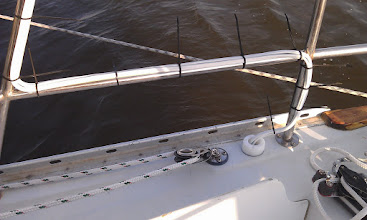 Photo: routing solar panel wire down to through deck fitting