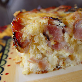 Breakfast Casserole with Potatoes, Ham, Eggs and Cheese.