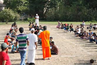 Photo: Swamiji explaing the game to students