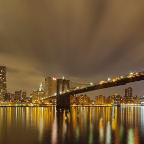 Brooklyn Bridge at night by Mike Lennett - Buildings & Architecture Bridges & Suspended Structures ( reflection, east river, suspension, manhattan, long exposure, night, mike lennett, bridge, new york, freedom tower, brooklyn )