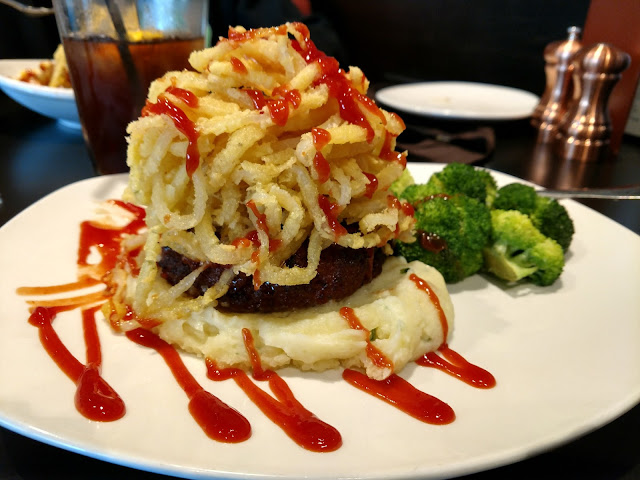 GF Meatloaf with garlic mashed potatoes, onion straws & sirachi ketchup.  Delicious!