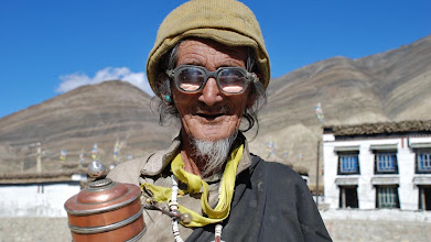 Photo: Shegar, old man with prayer wheel near the old fort ...