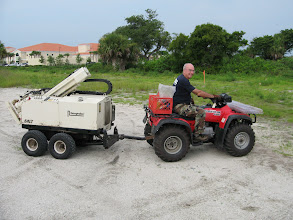 Photo: Farr on the go.  Normally the Geoprobe folks fit the 54LT with tracks and is self propelled but for archaeology we sometimes move 100s of meters between samples and the ATV provides more rapid movement and works well for us.