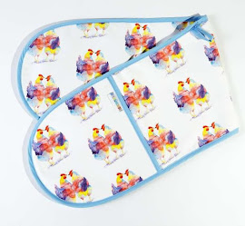 Oven gloves with printed animals on it