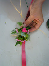 Photo: Use ribbon as the base material and raffia as tying material