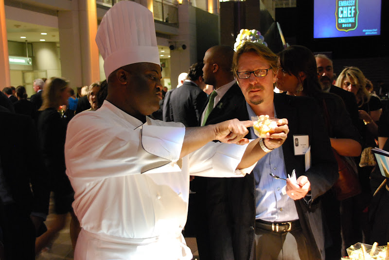 Photo: Chef Devin E. Johnson, Embassy of the Commonwealth of the Bahamas, and  judge Tim Carmen, food reporter for The Washington Post. Photo by Don Tanguilig