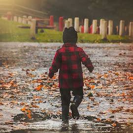Puddles by Jenny Hammer - Babies & Children Babies ( rain, toddler, puddles, baby, boy )