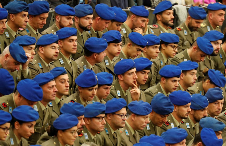 Italian soldiers attend the weekly general audience led by Pope Francis at the Vatican.