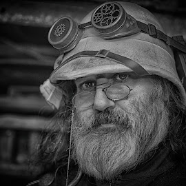 Bearded Steampunker by Marco Bertamé - Black & White Portraits & People ( chain, steampunk, beard, portrait, watching, glasses, looking into camera, spotting, goggles, spectacles, hat, looking, man )